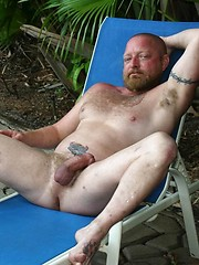 Ginger muscle pig Dawlton Hawg relaxes by the pool waiting for his next bareback conquest