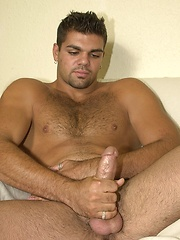 Beefy latin bear strokes his dick