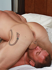 Mason Garet face is buried in Clark Longhammer inked shaved pubes as he sucks and services his throbbing cock