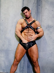 Muscled gay porn star Zeb Atlas in leather shirts