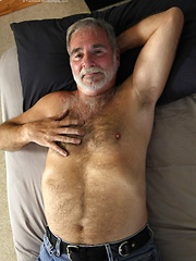 Hot older man grabs his hairy dick