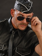 Hunky dad posing in solder and leather uniform