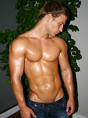Sexy stud oiled his body and posing before camera
