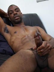 Beefy ebony dad touching his big black cock