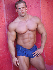 Strong bodybuilder from Miami beach posing for us camereman