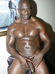 Big black man showing his nude and hairy chest