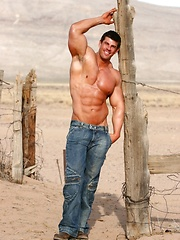Sexiest muscle hunk posing outdoor