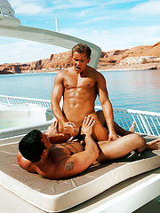 Athletic hunks have nice anal sex at yacht