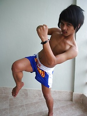 16 photos of cute gay Thai kickboxer posing and stripping